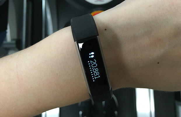 a Fitbit tracker showing 20,000 miles
