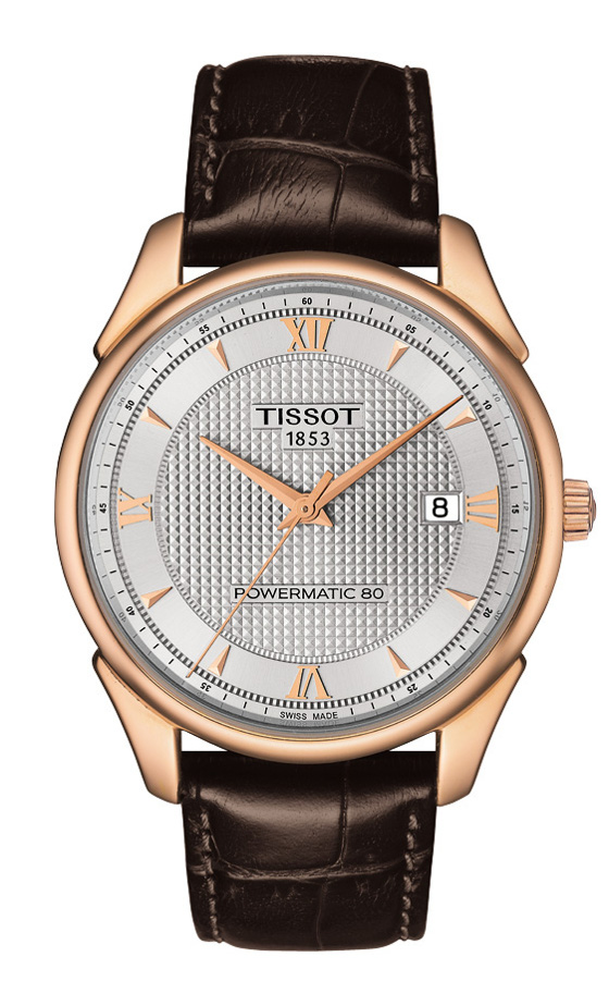 Front of Tissot Gold vintage watch with brown strap